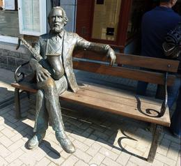 Adolphe Sax sits in front of his house in Dinant, Belgium, cradling his famous instrument. , Anne K - May 2011