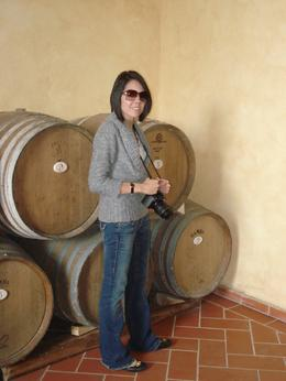Here is my daughter next to some of the wine barrels in the cellar, Francisco M - May 2010