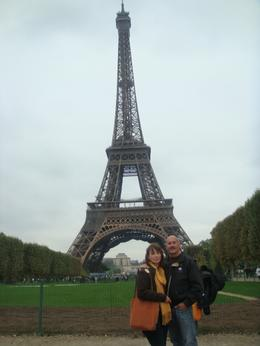 My husband and I in front of the Eiffel Tower, after the tour., HEATHER E - October 2010