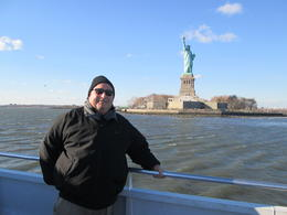 Statue of Liberty behind Paul on the boat tour , Paul L - December 2014