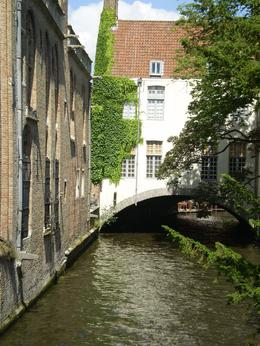 We're on the cruise going under the many bridges past the quaint old buildings in Bruges which was fantastic., Charles T - July 2010
