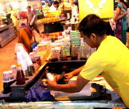 Food stall vendor making the chuski dessert - December 2012