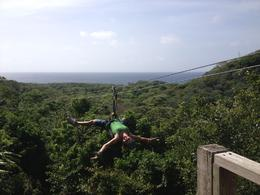 Kim laying back on the zipline in Roatan. , Martin Family - August 2013