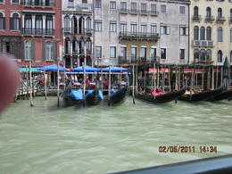 On the water bus on the Grand Canal passing gondolier and quot;bus stop and quot; , Christine P - May 2011