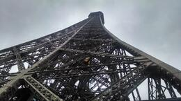 An upward view from under the Eiffel Tower , David S - May 2014
