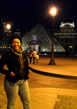 This is a photo of my taken in front of the Louvre Museum at night (of course another work of art by tour guide Antoine). I'm not sure if it's me or the museum that makes this photo beautiful! , Akeba - July 2013