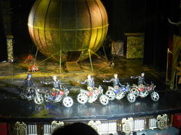 Acrobat show. All 5 men ride their motorbikes in the cage (behind) at the same time! , Lisa B - July 2012