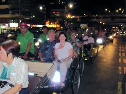 Our group of tourists enjoying the music and chatter of the trishaw drivers , Daniel C - May 2013
