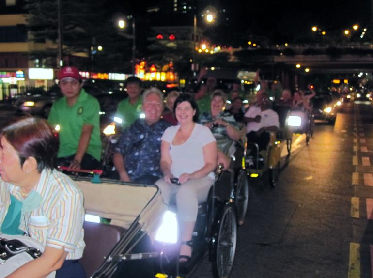 Trishaw Convoy stopped at lights - Singapore