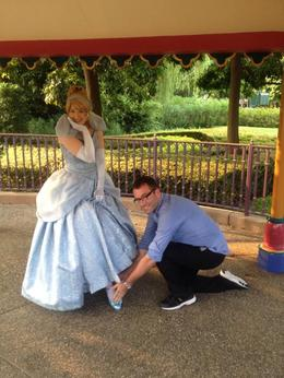 This is Marc, our school manager, trying to fit the shoe on Cinderella's foot, and become her prince charming. , Qing Yun L - August 2014
