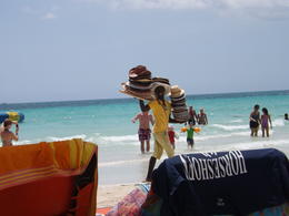 The Hat Man - one of many vendors seen on the Beach... , Tanya M - May 2013