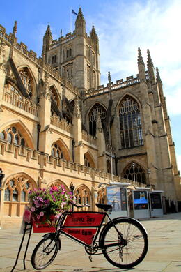 A cute bicycle with an ads in front of the Bath Abbey... , CECILE - September 2011