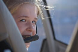 My Daughter Madeline is all smiles in the front of the Helicopter as it takes off , Andrew H - January 2012