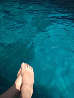 Sitting on the edge of the boat with the clear aqua water below! , ChloeHensel - August 2017