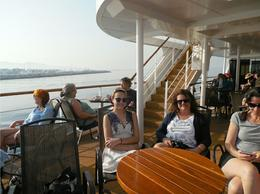 G'daughter and daughter enjoying the sunshine and smooth sailing of the cruise. , Kay - August 2017