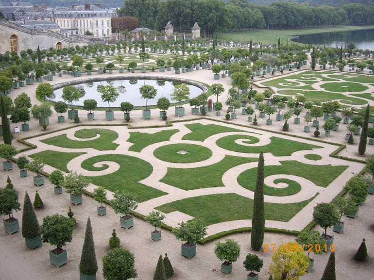 Manicured greenery at Gardens of Versailles - Paris