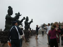 Statues giving offerings to Buddha, Emma R - March 2009