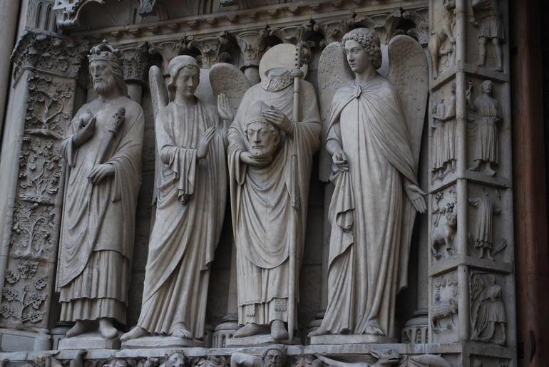 St. Denis statue, Patron Saint of France, outside Notre Dame - Paris