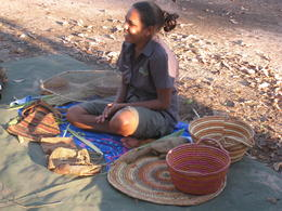 Deanne explaining some of the local customs, especially in regard to weaving bags and matts , Andrew M - May 2014