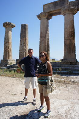 Ancient Corinth, My husband and I are in this picture. In front of us we had the view of the two seas divided by the Corinth Canal, and behind the ruins of the Ancient Corinth. , Isabel A - July 2011