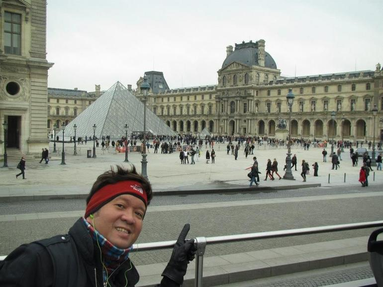 On top of the bus in front of the Louvre - Paris