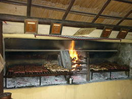 The asador on fire preparing our diner , Christian W - March 2012