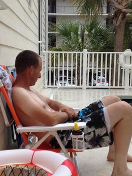 Mark sitting at the pool at condo , Cary S - April 2013