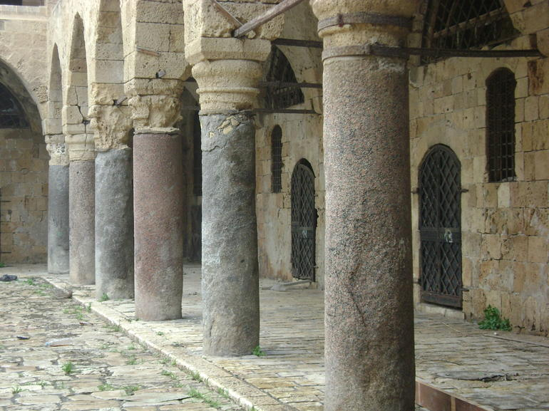 Akko courtyard - the pillars recycled from Caesarea - Tel Aviv