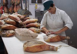 Worker apply lard to part of the ham prior to curing. , SAMUEL A - September 2015