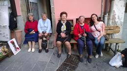 Grandmothers sitting in front of their houses in Riomaggiore. As you can see, the houses are very Tall, may only have 1 room per floor. , AnnMarie D - May 2014