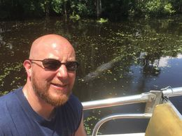 My husband being stalked by an alligator. , Nancy V - August 2016