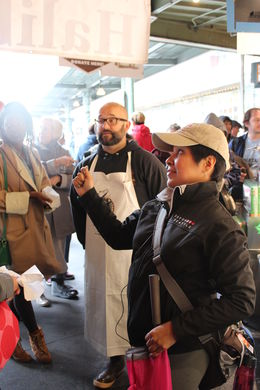 Carla our tour guide and one of the gentlemen at the fish market! , Velver G - May 2015