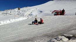 My husband and me sledding on the top of Mt. Titlis in Engleberg. , Katharine D. B - October 2014