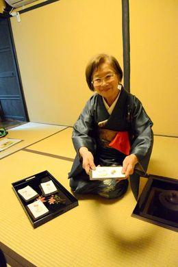 Tea master Seiko presenting a plate of sweets/ flavored sugar prior tea. , jason h - April 2016
