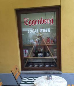 This is a window display of the local beer which was available inside this establishment. , Mary W - October 2016