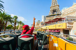 The Big Bus tour guide talking about the Eiffel tower as the tour drives past the Paris Casino., Viator Insider - December 2017