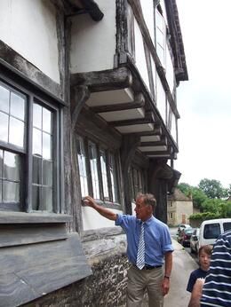 Our tour guide David talking about the untreated house timbers, Robert M - July 2010