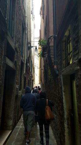 group walks on narrow streets behind the Plaza on the walking tour , chrisn - June 2015