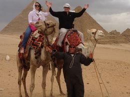 My wife and I and our camel herder our tour guide set us up with. Great experience and photo opportunity! , Phillip B - April 2015
