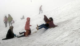 People playing around in the snow on the mountain , Mayank A - August 2014