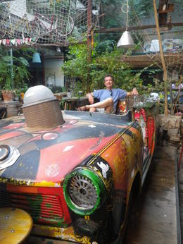 This is me sitting in the Trabant at the bar Szimpla in Pest. This picture was taken by our guide during the tour. It was a welcome break in our tour, as it was extremely hot that day. , David P - September 2013