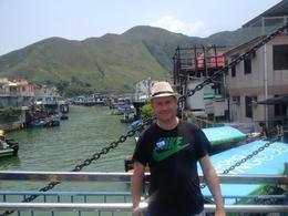 Andy, from Manchester, was enjoying the fishing village, but he had to go purchase a hat to protect his head from the scorching sun. A wonderful day together! , Qing Yun L - August 2014