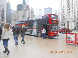 Bus at the bottom of Magnificent Mile on a rainy day , Rebekah A - May 2014
