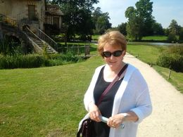 This is my wife standing near one of the prop hamlet dwellings. What a great way to end a delightful tour of Versailles. , Boris G - September 2015