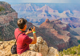 Tourist overlooking the South Rim of the Grand Canyon, Viator Insider - December 2017