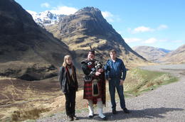 Here are we: Anna from left and Arto from right. In the middle of us there is a scot playing bagpipe. The guide has brought us to this great place and no we are having a photo taking break. It was ... , Arto K R - April 2013