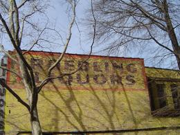 As it was mid winter, the bare trees revealed this old billboard on Roebling Street in Williamsburg., Robert R - April 2008