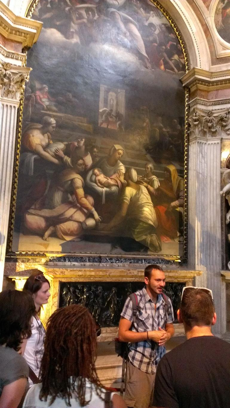 Tour guide in front of painting in church Santa Maria del Popolo - Rome