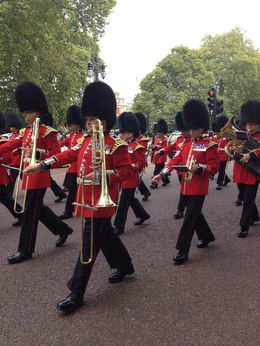 The guards, in their cherry tunics, marching up the Mall to Buckingham Palace., emmaknock - October 2015
