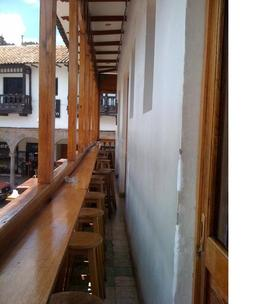There are many cafes and bars which surround the main square in Cusco. All of them are located on the second or third story of houses and have a great atmosphere., Bandit - December 2010